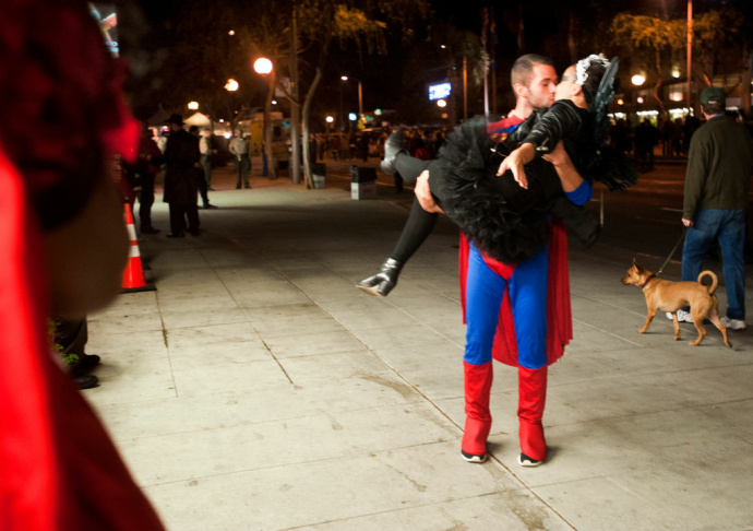 Gerry Regan, left, and Denny Gerber dance during the start of the West Hollywood Halloween Carnaval on Santa Monica Boulevard on Wednesday night.