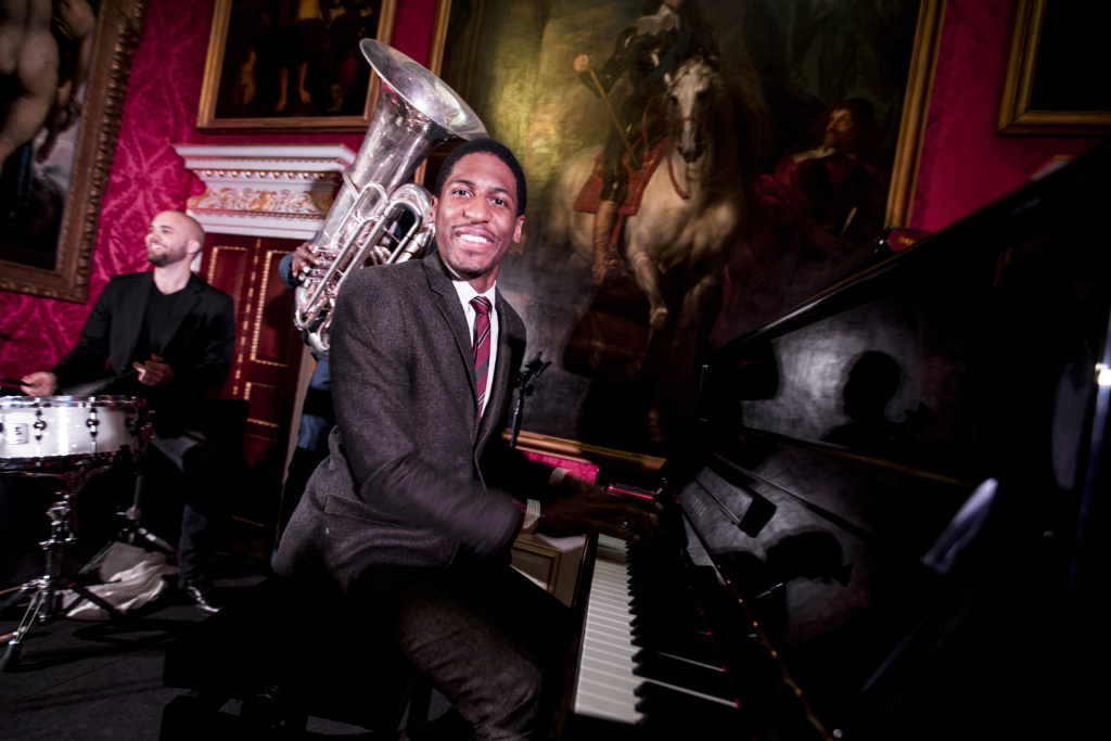 Jon Batiste performs live on stage at the Marketing Society event during day two of Advertising Week Europe at Kensington Palace State Apartments on April 1, 2014 in London, England.