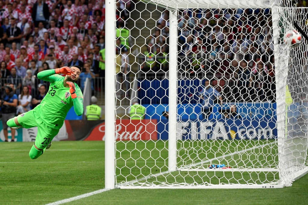 Croatia's goalkeeper Danijel Subasic concedes a goal during the Russia 2018 World Cup semi-final football match between Croatia and England at the Luzhniki Stadium in Moscow on July 11, 2018.
