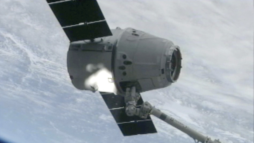 The SpaceX Dragon cargo vehicle is grappled by the International Space Station's robotic arm Sunday morning.