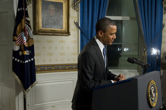 President Barack Obama leaves after speaking during a reenactment of his speech on the budget for press photographers in the Blue Room of the White House in Washington, DC, April 8, 2011, after Congress reached an agreement to pass a budget.