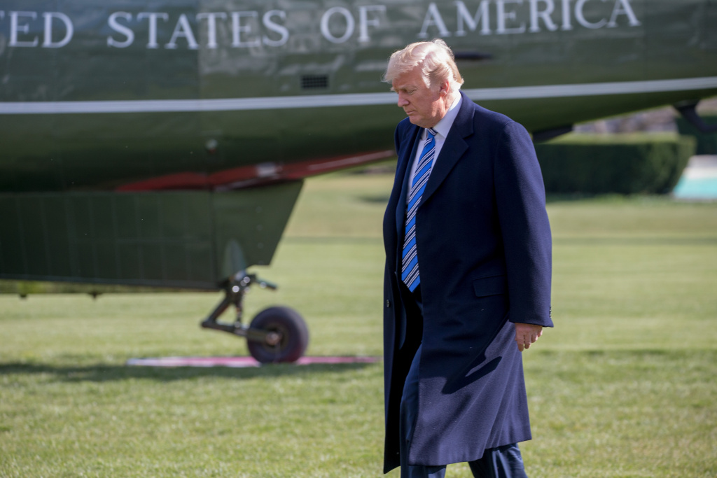 U.S. President Donald Trump walks from the Oval Office to the Marine One helicopter as he departs for Mar-A-Lago from the South Lawn of the White House on March 23, 2018 in Washington, D.C.