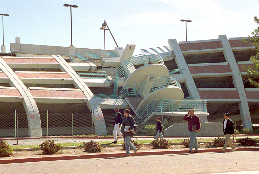 University of California, Northridge, students walk by a parking structure that was heavily damaged on the CSUN campus in the Jan. 17, 1994 earthquake.