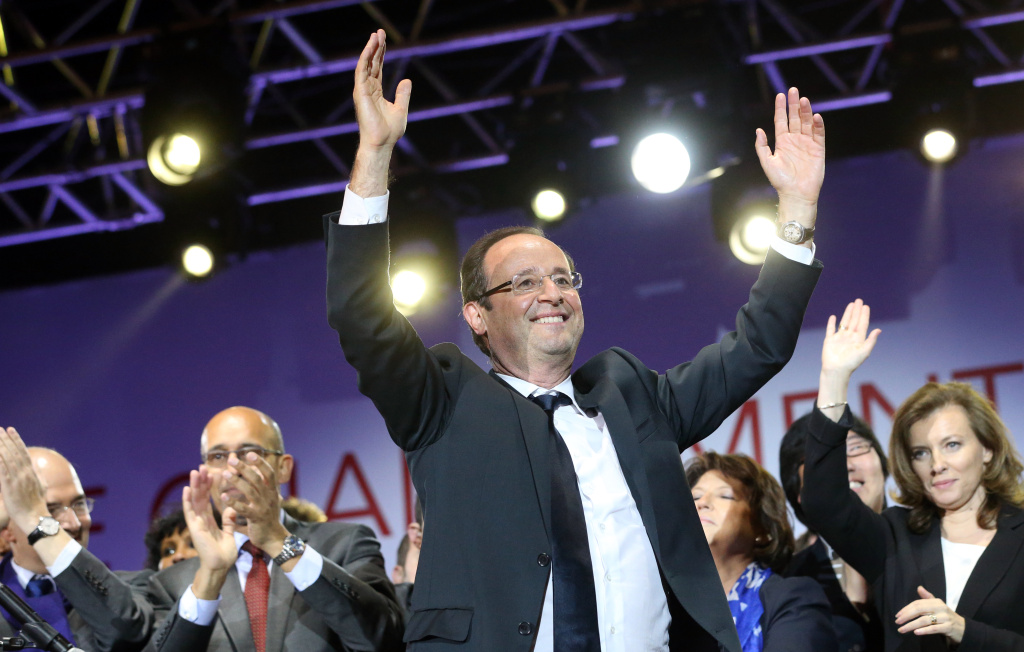 France's Socialist Party (PS) newly elected president Francois Hollande celebrates at the Place de la Bastille in Paris on May 7, 2012 after the announcement of the first official results of the French presidential second round. Hollande was elected France's first Socialist president in nearly two decades on May 6, 2012 dealing a humiliating defeat to incumbent Nicolas Sarkozy and shaking up European politics.
