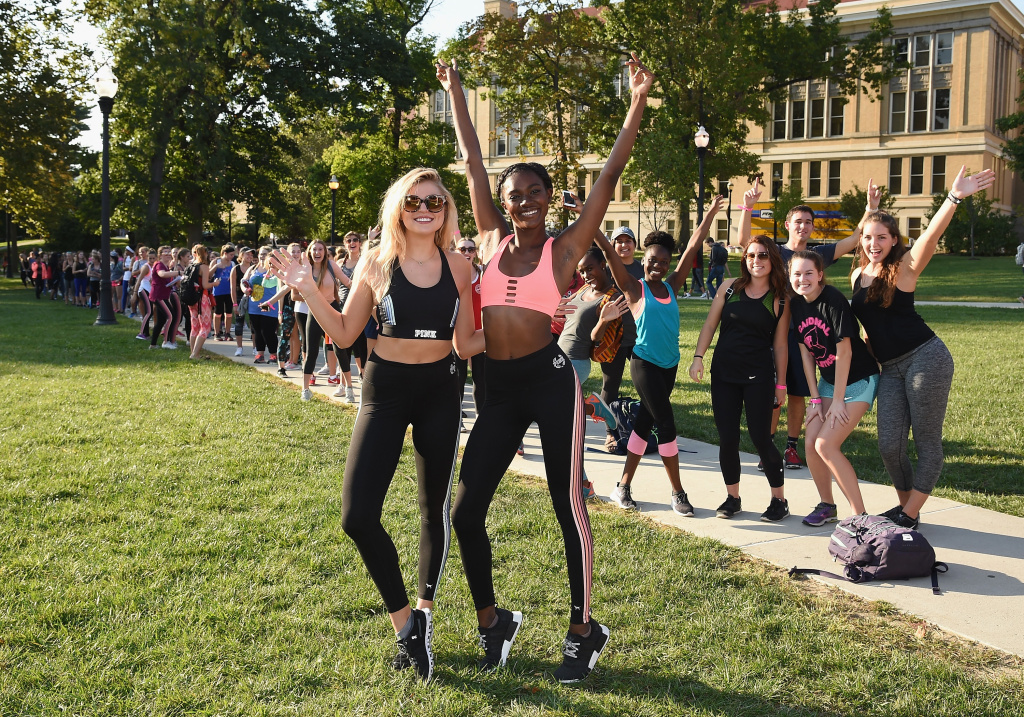 Victoria's Sectet models Zuri Tibby and  Rachel Hilbert pose with guests at Ohio State University on October 5, 2016.