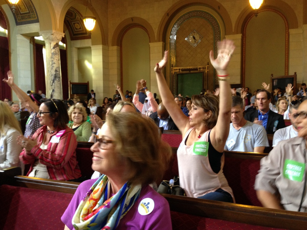 Supporters of Airbnb and home-sharing applaud after hearing testimony from a colleague at a hearing at Los Angeles City Hall in 2016.