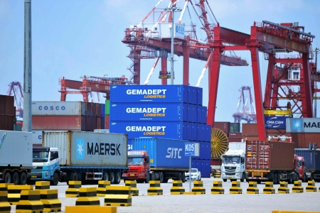 Containers are transferred at a port in Qingdao in China's eastern Shandong province on July 6, 2018. The Trump administration announced plans to levy tariffs on another $200 billion of Chinese goods as trade tensions escalate.