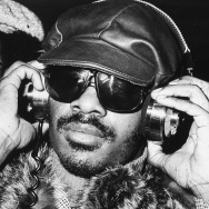 Stevie Wonder listening to headphones