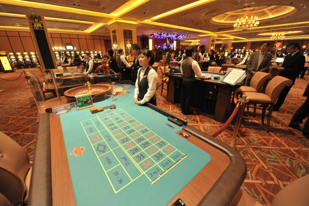 A croupier waits for customers at a table in The Four Seasons Hotel casino in Macau on Aug. 28, 2008.