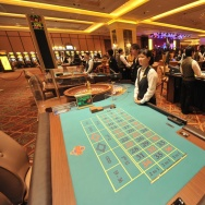 A croupier waits for customers at a tabl