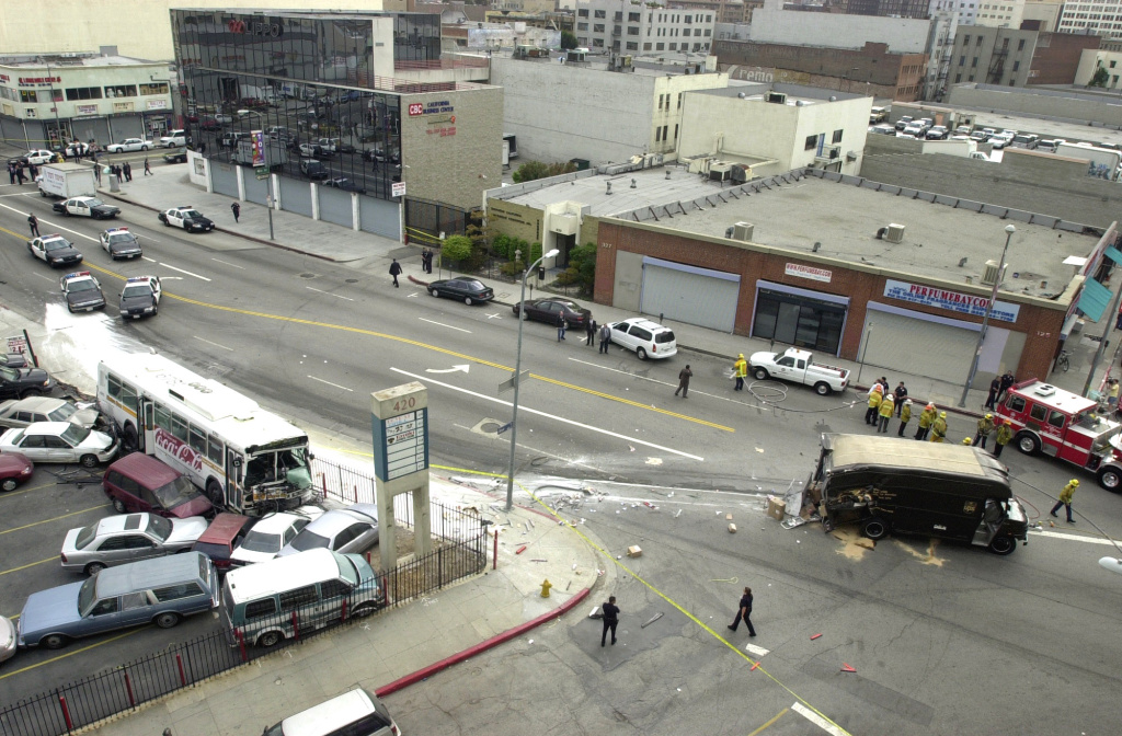 A Metropolitan Transit Authority bus that was hijacked by a gunman and a UPS truck lie wrecked after crashing May 2, 2001 in Los Angeles, CA.
