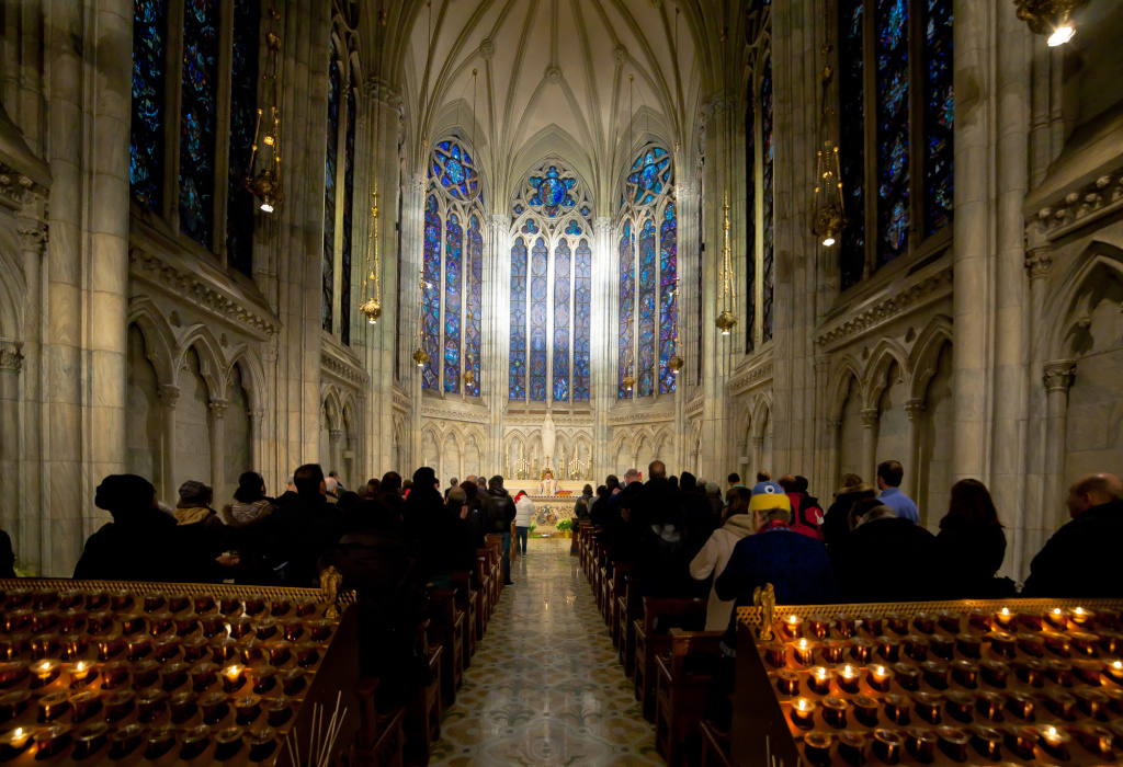 Catholic worshipers attend Mass at Saint Patrick's Cathedral in New York City. Celebrating Holy Communion without shared wine is fine, in the age of COVID-19, many churches have decided.