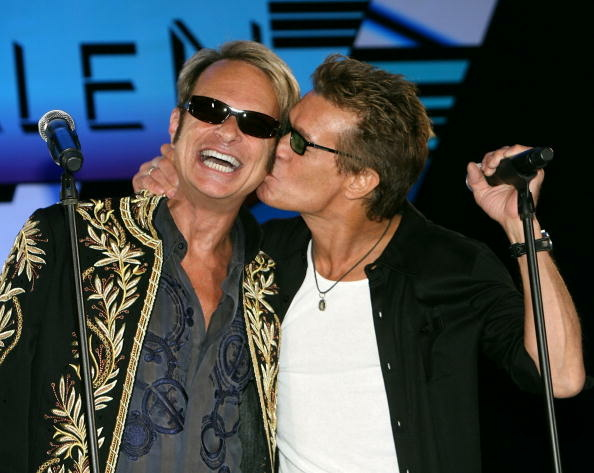 LOS ANGELES, CA - AUGUST 13: David Lee Roth (L) recieves a kiss from guitar player Eddie Van Halen at the Van Halen Press Conference announcing their new tour at the Four Season Hotel on August 13, 2007 in Los Angeles, California. (Photo by Michael Buckner/Getty Images)