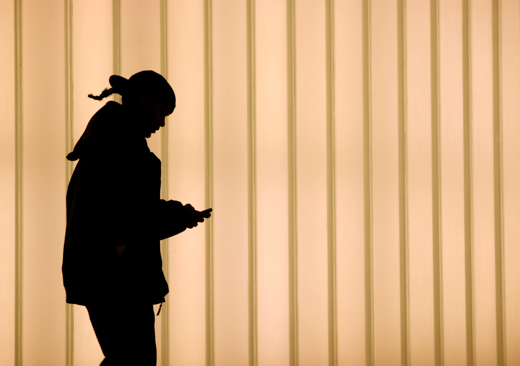A woman using a cell phone on November 12, 2010.