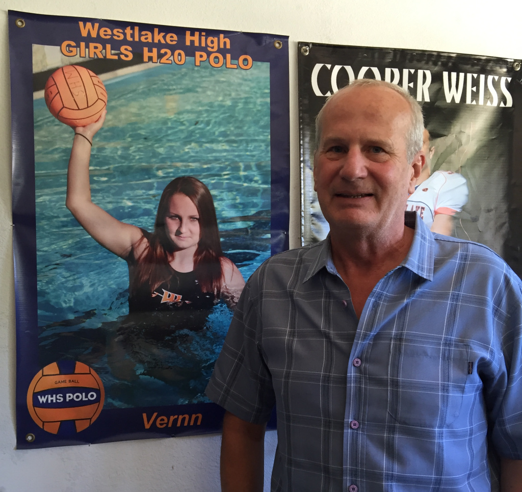 Bob Weiss with a poster of his daughter, Veronika, who was killed in a mass shooting near UC Santa Barbara in 2014. He's campaigning for Proposition 63.