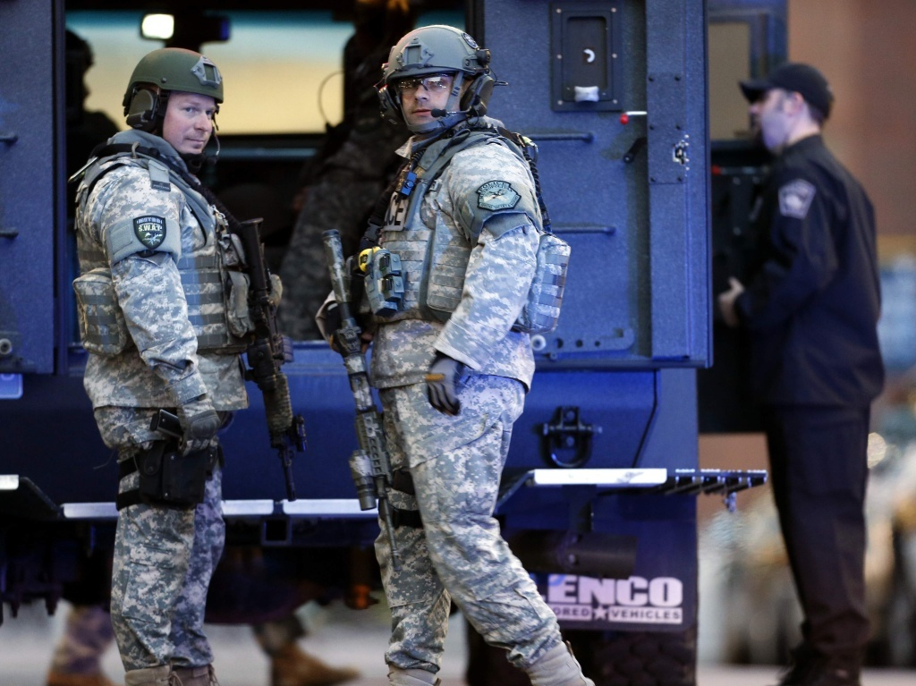 SWAT team members stand guard on the campus of Massachusetts General Hospital following the explosions at the finish line of the Boston Marathon.
