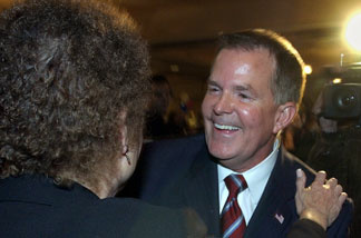 State Sen. Roy Ashburn, R-Bakersfield, receives a hug from Jane Parsons, chairman of the Fresno County Republican Party, during an election-night party held in Fresno Tuesday, Nov. 2, 2004.