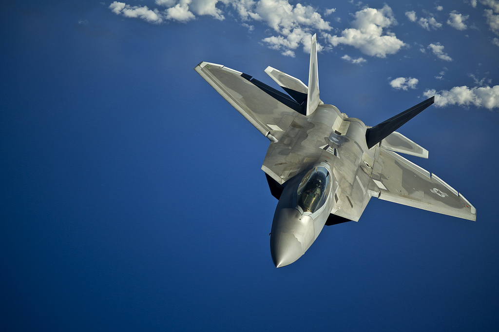 An F-22 Raptor from the Hawaii Air National Guard's 199th Fighter Squadron returns to a training mission after refueling March 27, 2012, over the Pacific Ocean near the Hawaiian Islands. (U.S. Air Force photo/Tech. Sgt. Michael Holzworth)