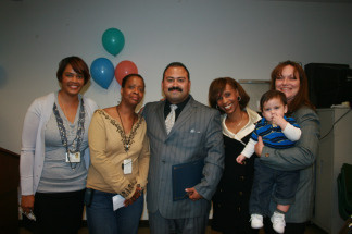 (L to R) Caseworkers Karen Gage and Yvonne Holman, Ernest Melendrez, caseworker Kendra Tankersley and Ernest's fiancee Launi Perry and their 9-month-old son at the Family Reunification Week celebrations organized by Los Angeles County Department of Children and Family Service, in their Vermont Corridor office on March 2, 2010.