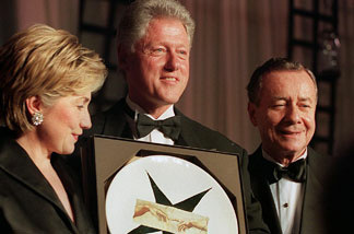 File photo: US President Bill Clinton (C), First Lady Hillary Rodham Clinton (L) and National Italian American Foundation President Joseph Cerrell (R) are pictured at the NAIF Gala Dinner 16 October 1999 in Washington, DC.