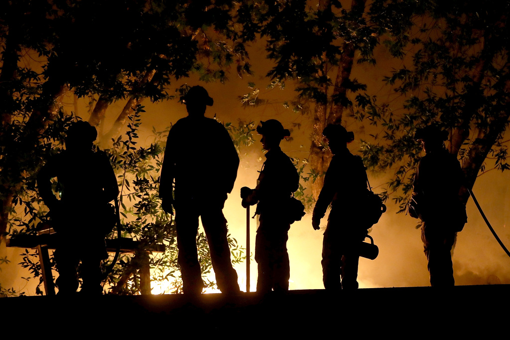 CalFire firefighters battle the Tubbs Fire on October 12, 2017 near Calistoga, California.