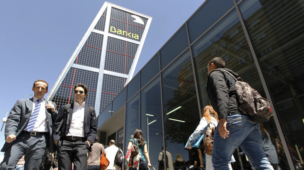 The Spanish government took a controlling stake in Bankia, the country's fourth-largest bank and largest real estate lender, on Wednesday.