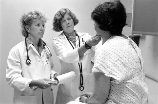 File: Doctors speak to patient.
