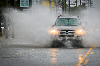 A Mercedes Benz SUV drives through heavy rains Sunday, March 20, 2011 in the San Fernando Valley.