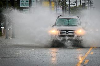 A Mercedes Benz SUV drives through heavy rains Sunday, March 20, 2011 in the San Fernando Valley.