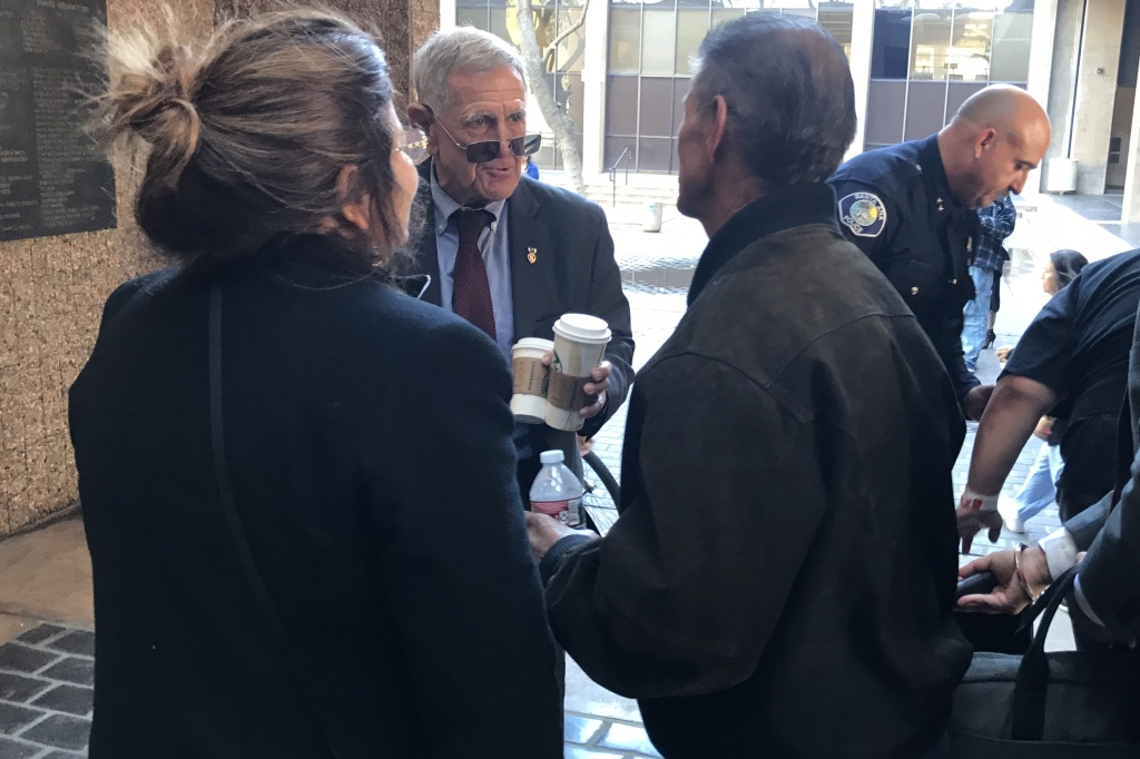 U.S. District Court Judge David Carter talks to advocates for the homeless outside of a court hearing on homelessness on March 17, 2018. Orange County leaders and homeless advocates have praised the judge for forcing the county to address chronic homelessness.