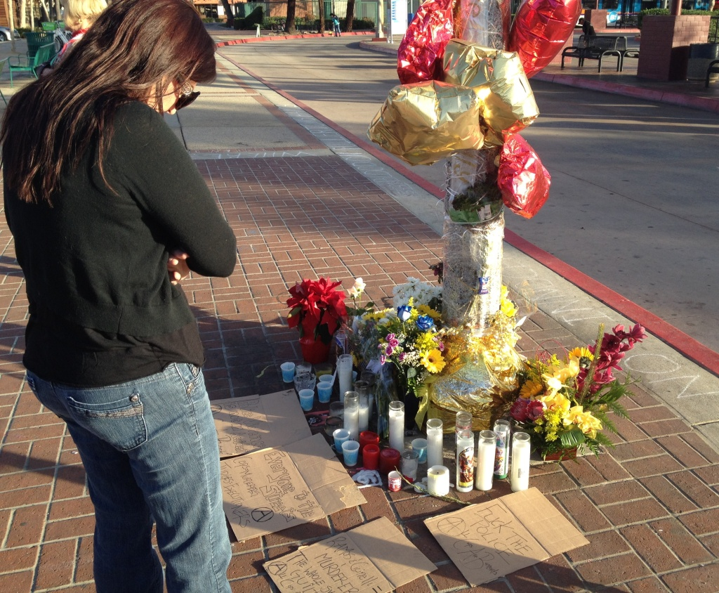 Libby Post stands at a makeshift memorial for Kelly Thomas Tuesday morning, Jan. 14, 2014, after acquittal of ex-cops in Kelly Thomas death trial.