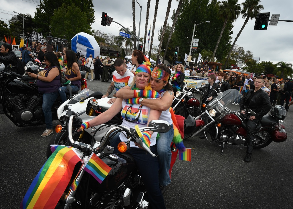 Participants take part in the 2016 L.A. Pride Festival parade in West Hollywood on June 12, 2016.