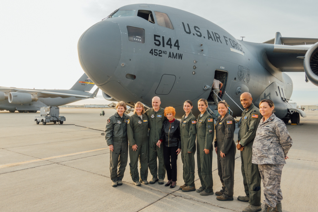 Elinor Otto (fourth from the left) poses with members of the flight crew and Air Force Reserve officials, including Lt. Gen. Maryanne Miller (left), the first female commander of the Air Force Reserve.