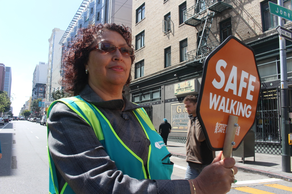 Margarita Mena, 60, stops traffic for pedestrians in San Francisco's Tenderloin neighborhood on April 24, 2018. Mena, a Tenderloin resident, helped start the Safe Passage program.