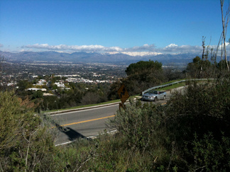 A view from Mulholland Drive at the Stone Canyon Overlook in Beverly Glen on Saturday, Jan. 23, 2010, shows the snowy Angeles National Forest as a backdrop at the edge of the San Fernando Valley.