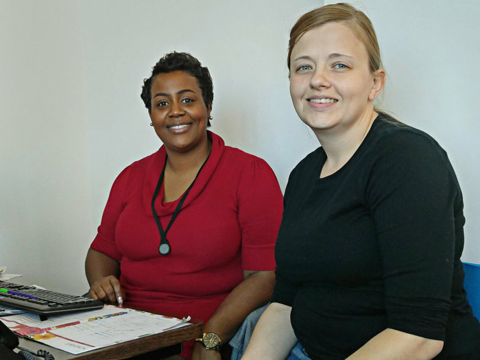 Sharita Moultrie, left, a navigator with the Palmetto Project, helps Stephanie Hickman enroll in an Obamacare plan in Columbia, S.C.
