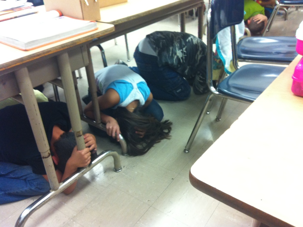 The 3rd grade class at Rosemont Elementary School in Los Angeles participates in the Great ShakeOut earthquake drill that occurred at exactly 10:17a.m. across the country on Thursday, October 17, 2013.