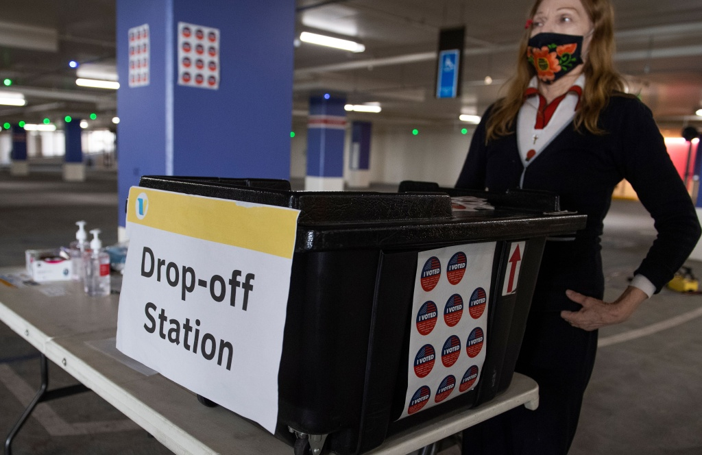 A woman stands near a ballot drop-off station at a voting center set up in a parking garage at Beverly Hills City Hall, October 27, 2020, in Beverly Hills, California.