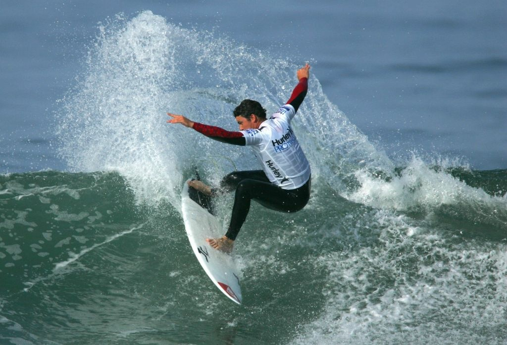 Peter Mel (USA) slashes a turn on an inside wave in Heat 3 of the Round of 172 of the 2009 Hurley U.S. Open of Surfing on July 19, 2009 in Huntington Beach, California.