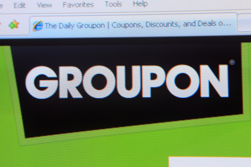 The Groupon logo is displayed on the company's website.