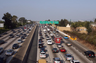 Drivers on the 110 Freeway south of downtown Los Angeles can exercise a new option - toll lanes for carpools and solo drivers with transponders. L.A. County Metro has begun a one-year experiment that ends a 70-year tradition of