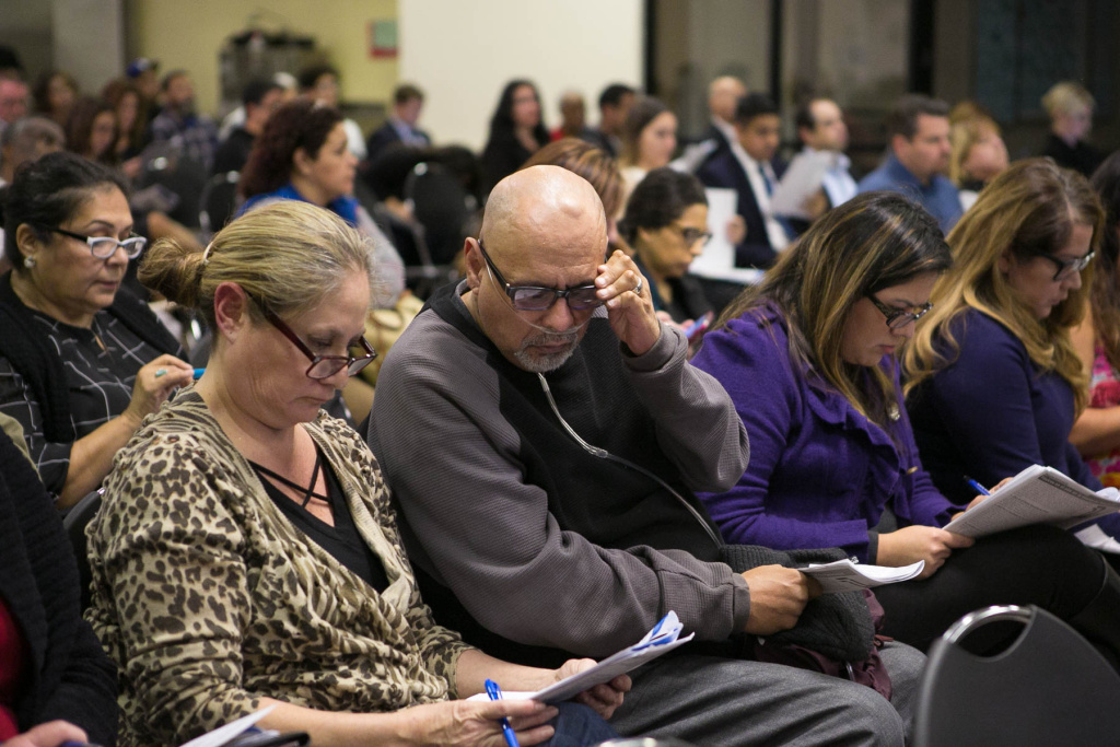Michael Alva, center, and Laurie Guillen, right, at a town hall at the Paramount Community Center hosted by the AQMD and the L.A. County Department of Public Health. The agencies were updating the public on the investigation into elevated levels of hexavalent chromium.