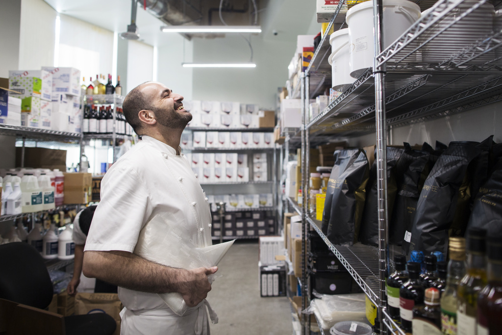 Executive Chef Vartan Abgaryan stands in the dry storage room for 71 Above, the new restaurant on the 71st floor of the U.S. Bank Tower in downtown Los Angeles, on Thursday afternoon, Sept. 22, 2016.