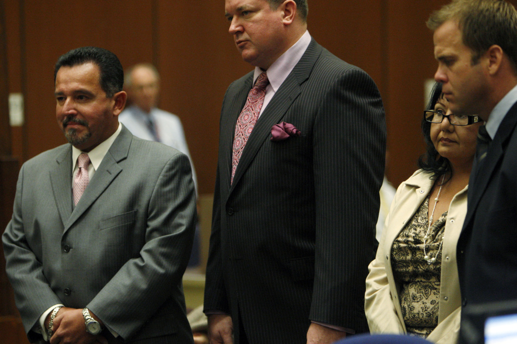 Irwindale City Councilman Mark Breceda, left, and former Irwindale City Councilwoman Rosemary Ramirez, second from right, appear to face charges of misappropriation of public funds at the Criminal Courts building in downtown Los Angeles on Wednesday, Oct. 27, 2010