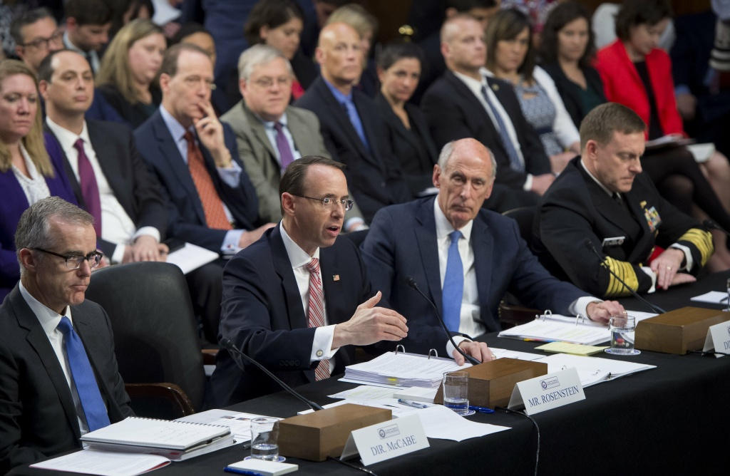 (L-R) Acting FBI Director Andrew McCabe,  Deputy Attorney General Rod Rosenstein, Director of National Intelligence Dan Coats and National Security Agency (NSA) Director Michael Rogers testify during a Senate Select Intelligence Committee hearing.