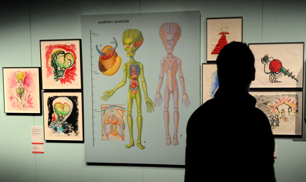 A visitor looks at the Anatomy of a Martian at an exhibition, presented as part of Melbourne Winter Masterpieces 2010, which explored the full career of artist and film maker Tim Burton.