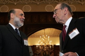 US Federal Reserve Chairman Ben Bernanke (L) confers with former chairman Alan Greenspan (R) at a party to honor Jean-Claude Trichet, President of the European Central Bank 18 October 2007 at the Hay Adams Hotel in Washington, DC.