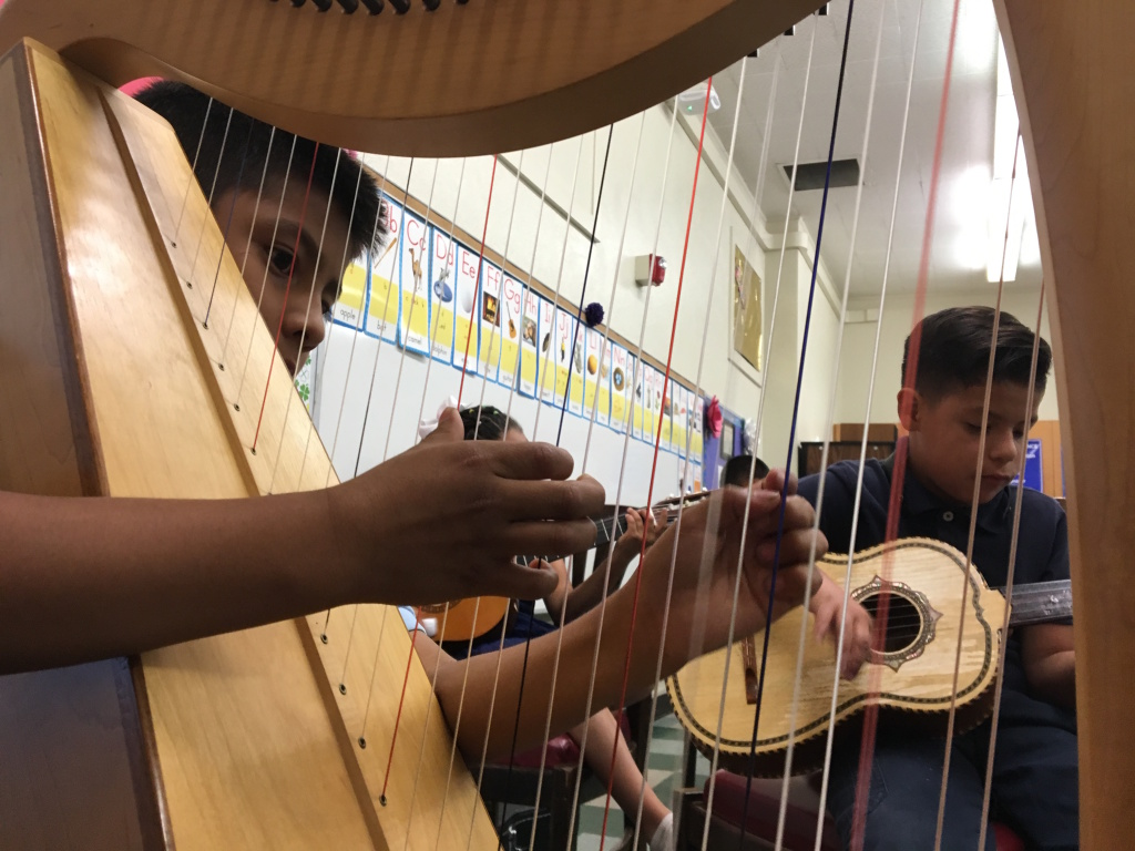 Students in Haddon STEAM Academy's mariachi band play during practice on June 3, 2016. The band meets as an elective class during the school day. Students play donated instruments and, during performances, wear authentic trajes (suits) valued at $300 apiece. Principal Richard Ramos sought to start the program as a means of breathing new life into the school, which was struggling when he arrived in 2014.