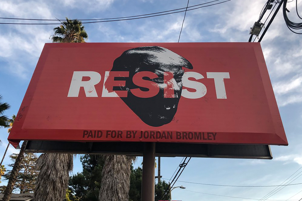 A 'Resist' billboard in Los Angeles. Federal workers are being advised by a government ethics agency to avoid discussing impeachment or what's known as the 'resistance' movement to President Trump while at the workplace.