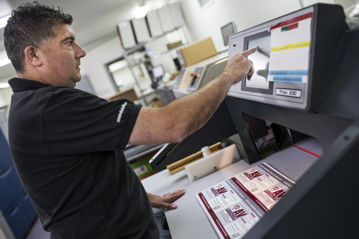 Machine Operator Lucio Sandoval inserts campaign mailers into an address printer at Mellady Direct Marketing in Santa Clarita, Calif. on Thursday morning, Oct. 6, 2016. The inkjet addressing machine prints about 15,000 addresses per hour.
